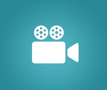 Foto de um símbolo branco do cinema em um fundo verde