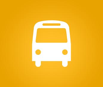 Foto de uma representação de ônibus com fundo amarelo