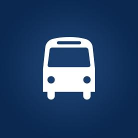 Foto de um ônibus branco em fundo azul escuro