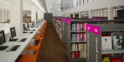 Corredor de uma biblioteca com computadores e estantes