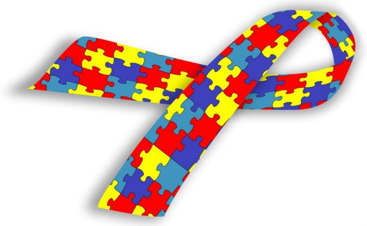 Símbolo mundial da conscientização do transtorno do espectro autista com um laço formado por um quebra-cabeça, de peças coloridas