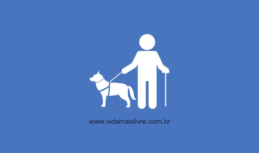 Em fundo azul , ícone de um homem cego com uma bengala e um cão-guia