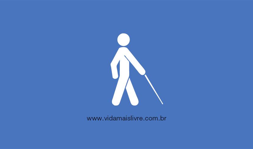 Em fundo azul, ícone em branco que representa um cego caminhando com uma bengala